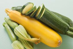 Green and yellow courgettes with courgette flowers