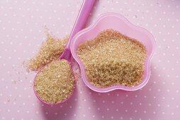 Brown sugar in pink dish