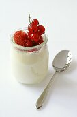 Natural yoghurt with strawberries and redcurrants