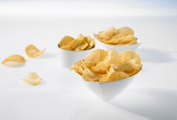 Crisps in three small bowls