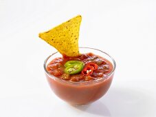 Taco chip in tomato dip
