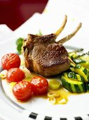 Lamb chop with courgettes and tomatoes