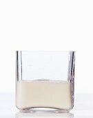 Oat milk in a square glass