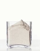 Buckwheat flour in a square glass
