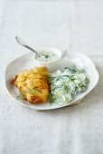 Fish in batter with cucumber salad and remoulade