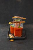 Gazpacho in three glasses with anchovy crostini
