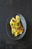 Fried red snapper on banana salad with curried onions