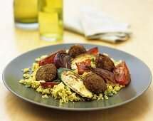 Falafel (store-bought product) with courgettes on couscous