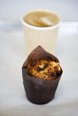 Muffin and coffee in plastic cup