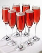 Champagne with strawberry syrup