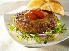 Burger with rocket, onions and ketchup