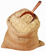 Rice in jute sack with scoop