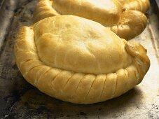 Cornish pasties on a baking tray