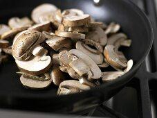 Sliced mushrooms in a frying pan