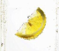 Lemon wedge in mineral water