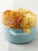 A mini cheese soufflé in a ramekin