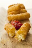 Deep-fried cheese and onion croquettes in beer batter