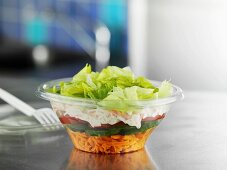 Layered salad in plastic container to take away