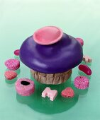 Muffin with purple icing and flying saucer, sweets