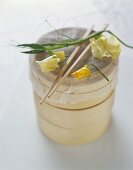 Bamboo basket with cheesecloth, chopsticks and flowers