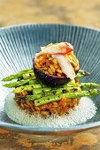 Crab risotto with grilled green asparagus and passion fruit sauce