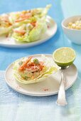 Iceberg lettuce with prawns and avocados