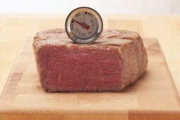 The core temperature of a beef steak being taken (rare)