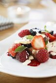 Kaiserschmarrn (shredded sugared pancake from Austria) with ice cream and berries