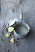 Lime juice with sugar in a saucepan