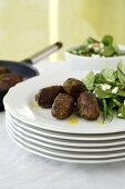 Herb meatballs with a spinach and bean salad and feta cheese