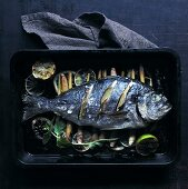Fried bream on lemongrass and lime slices