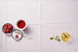 Fresh raspberries, raspberry sauce and sugar
