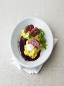 Saucisson with mashed potatoes and red wine shallots