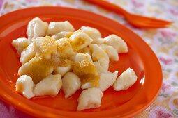Polish Kopytka with bread crumbs (potato dumplings)
