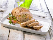 Stuffed ham with vegetables