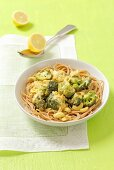 Whole grain spaghetti with broccoli, cashews and curry sauce