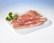 Several bacon slices (uncooked)