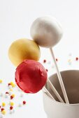 Cake pops, white, yellow and red
