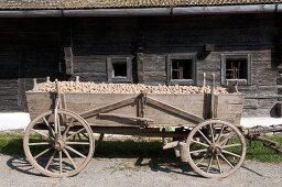 Potatoes in a wooden cart