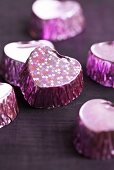 Purple-coloured, heart-shaped pralines