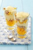 Layered desserts with peaches, sesame rings and vanilla cream