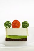 Goat's cream cheese on pumpernickel bread with avocado