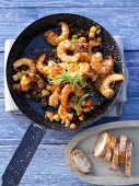 Prawns in melasse sauce with peppers and tomatoes