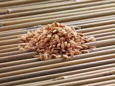 Red rice on bamboo sticks