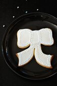 Shortbread biscuits (bows) with white icing