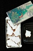 Shortbread biscuits with white icing and a Christmas card