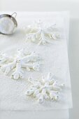 Iced snowflakes on baking paper