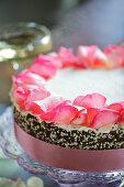 A wedding cake with rose petals