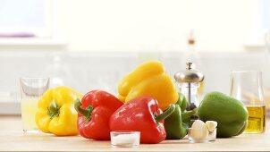 Colourful peppers, salt, garlic, olive oil
