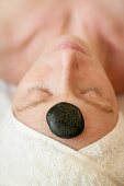 A stone massage for the head